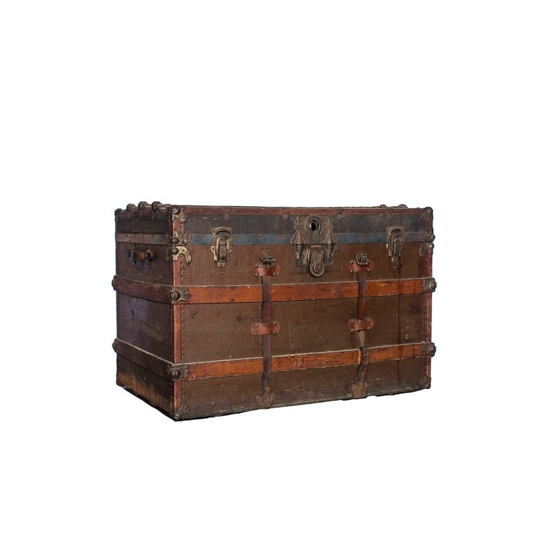 Large wooden and leather trunk with brass hinges.