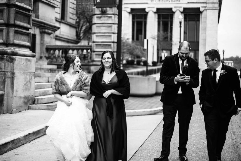 Bridal party walking  together outside the Washington County Courthouse in  Washington, PA