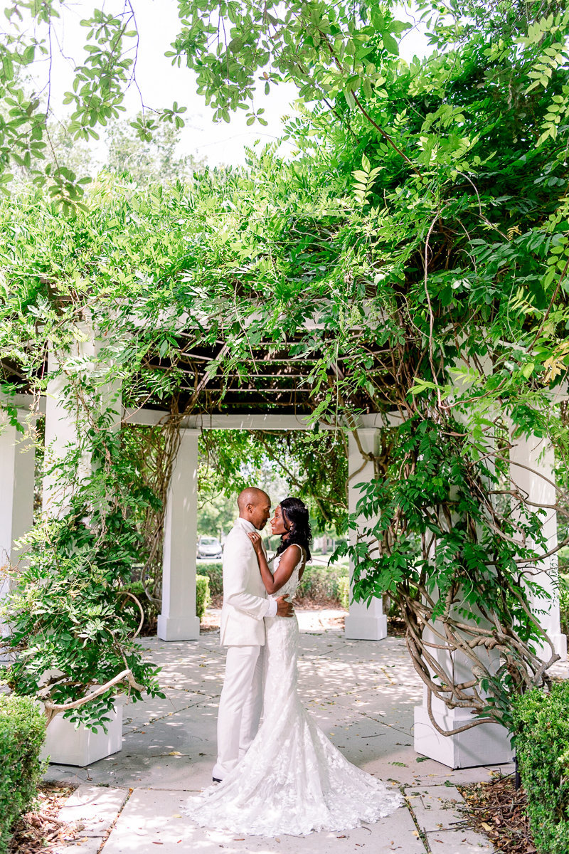 Orlando Wedding Photographer | Cypress Grove Estate House Wedding | Bride and Groom Portraits under arch-1
