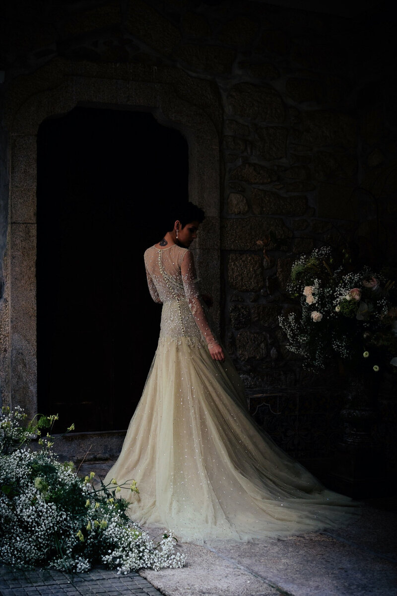 Bride in front of flowers at Castelo de Portulezo