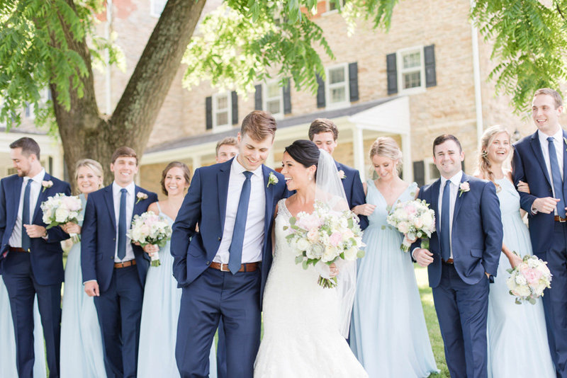wedding party and bride and groom walking at springfield manor winery and distillery wedding by costola photography