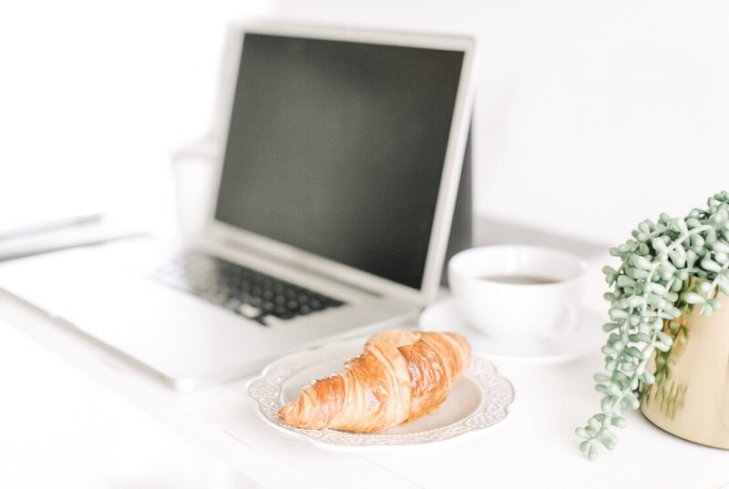 Picture of laptop and croissant