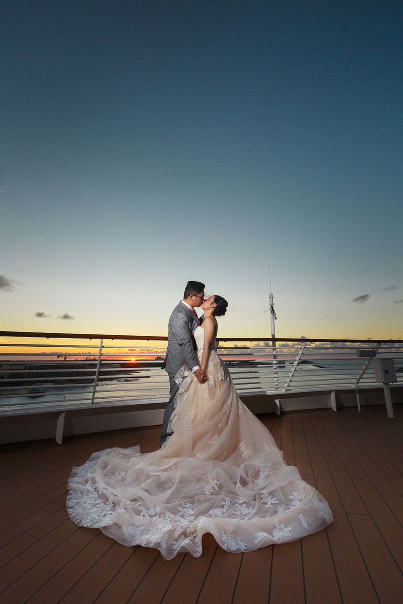 Bride and Groom Kiss on the Deck at their Disney Cruise Ship Wedding Photo Shoot in Nassau Bahamas