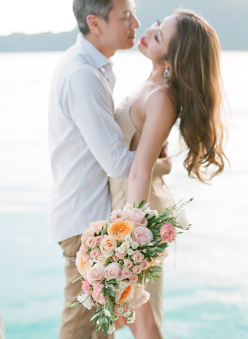 Sensual couple portrait with flowers