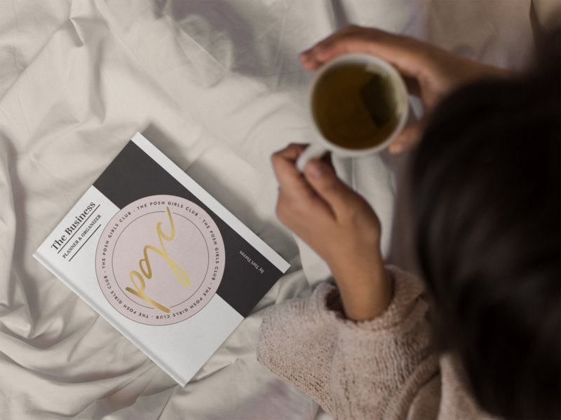 mockup-from-above-of-a-girl-reading-a-book-and-drinking-a-tea-while-in-bed-a14299