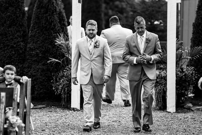 Groom walks down the aisle before weding ceremony at Port Farms
