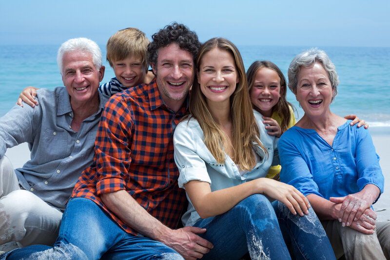 cheerful-multi-generation-family-relaxing-beach (1)