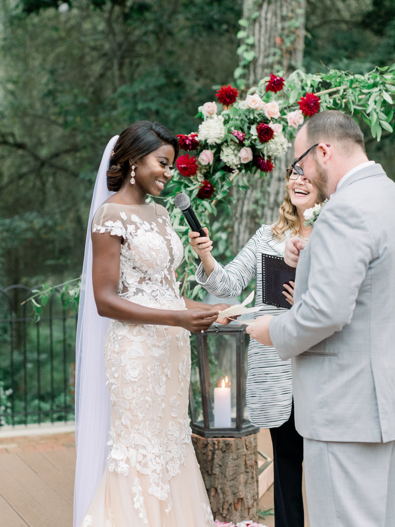 A multicultural couple exchanges rings at Hotel du Village. The couple chose Donna Forsythe of Lehigh Valley Celebrants to be their wedding officiant.
