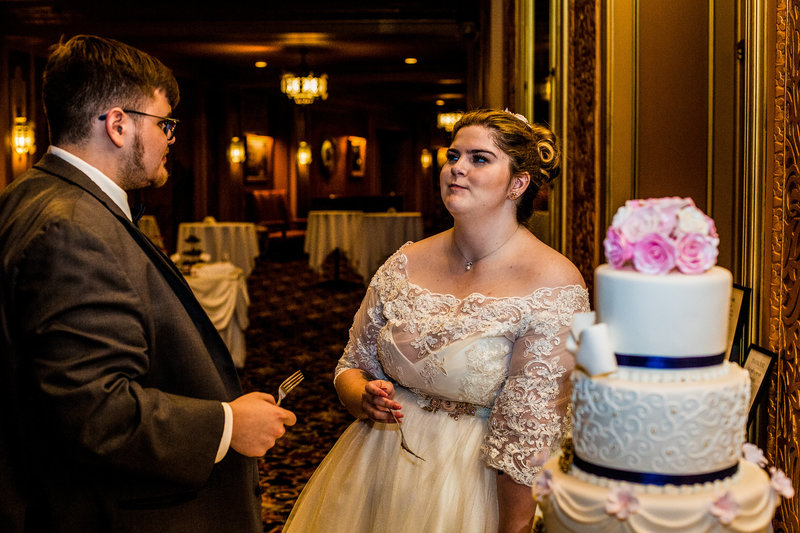 Bride and groom eating cake at Warner Theatre wedding