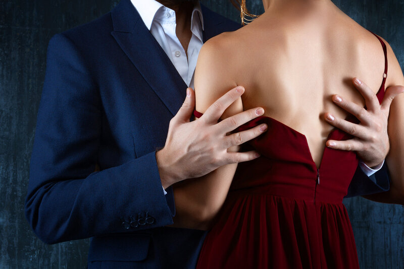 stock photo - man suit hands woman red dress