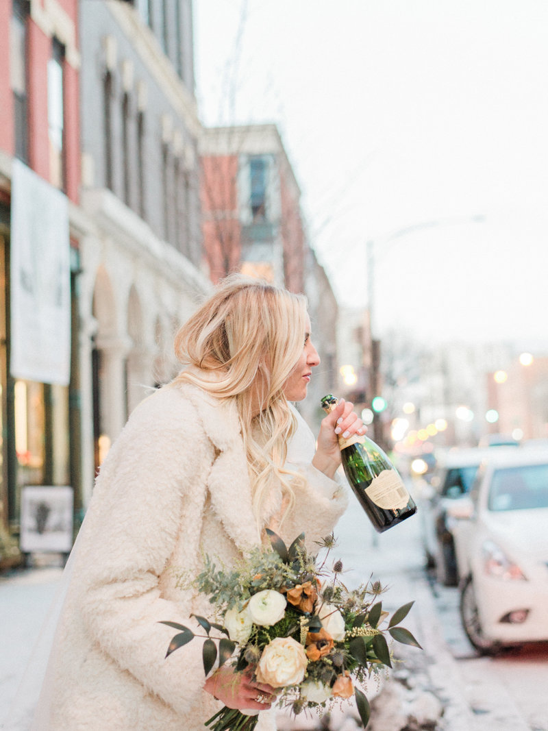 bride-drinking-champagne-photo
