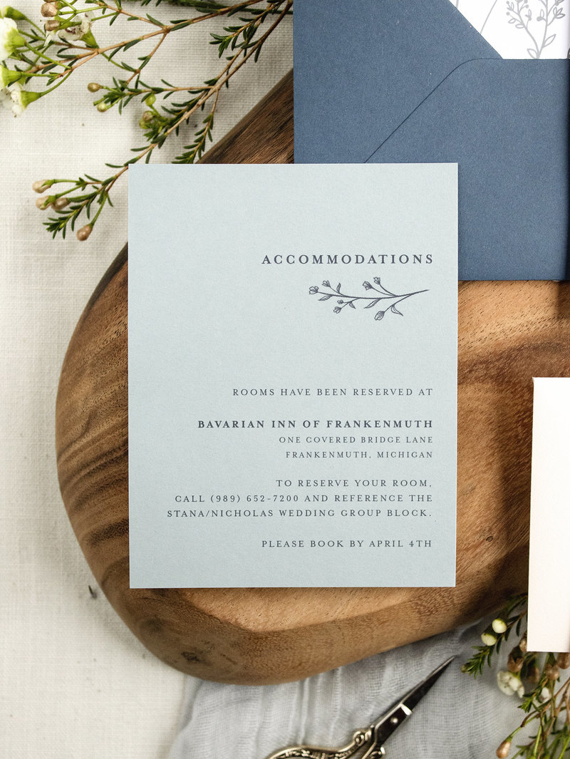 Accommodations info shown on a Dusty Blue cardstock with navy text and accents.