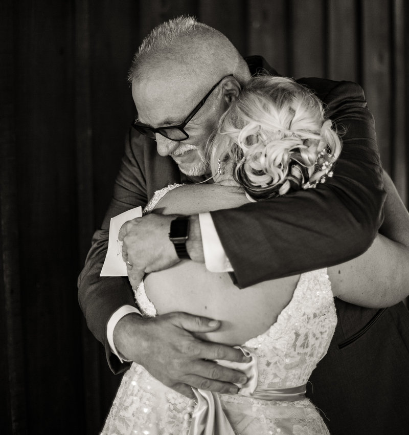 Bride hugs her father before Betsy's Barn wedding