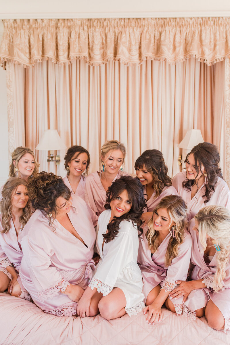 bridesmaids in robes at great marsh estate wedding in charlottesville virginia by costola photography