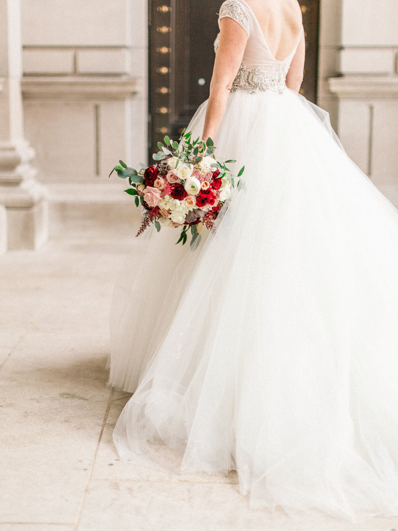 Bride with bouquet in front of Carnegie Institute for Science in Washington DC