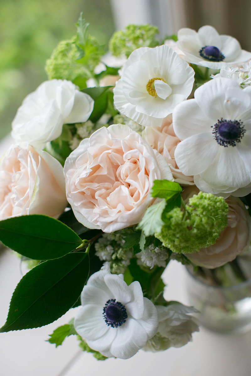 Garden rose and anemone wedding centerpiece