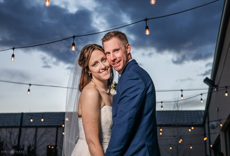 Couple photographed on the outdoor patio at Black Foreest by Wedgewood Weddings