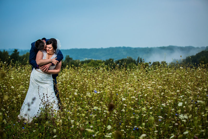 Couple in a field of wildflowers