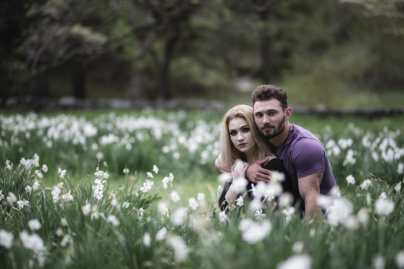 Couple's portrait on location in a field of flowers