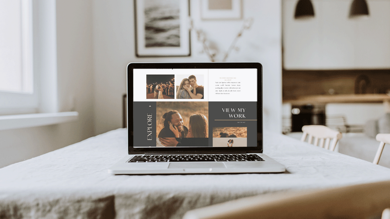 Laptop featuring Showit web design for wedding photographers sitting on a table with white linen