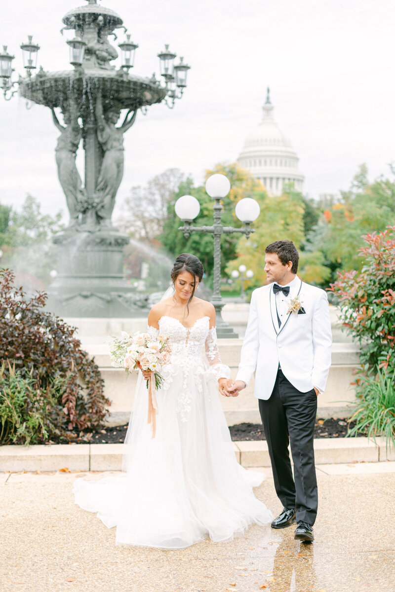 bride and groom walking by fountain at Washington DC Romantic Classic Wedding at the Lincoln Memorial by Costola Photography