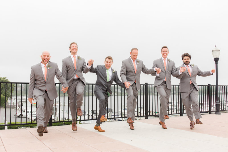 Fun groomsmen pose