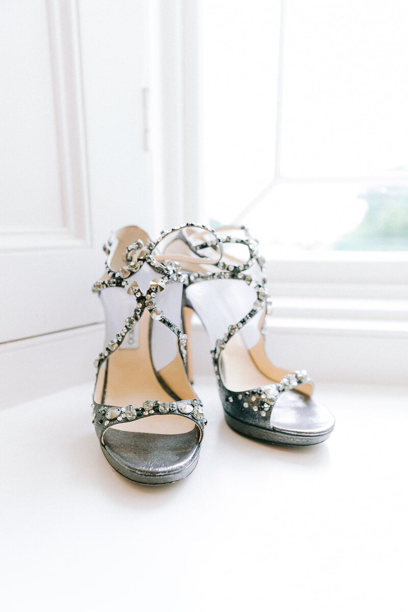 Jimmy choo wedding shoes in the bridal suite window with diamond accent