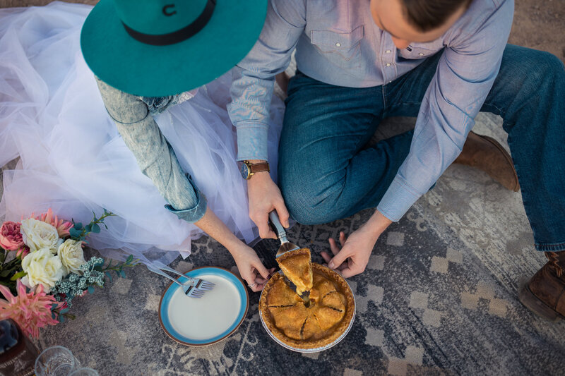 bride and groom cutting apple pie after their elopement