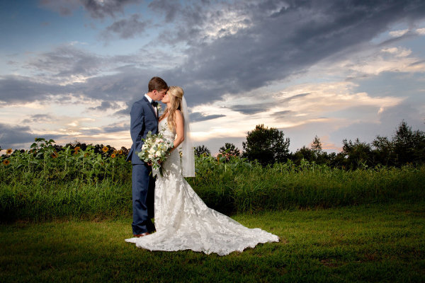 Bride and groom share a kiss at Wildberry Farm