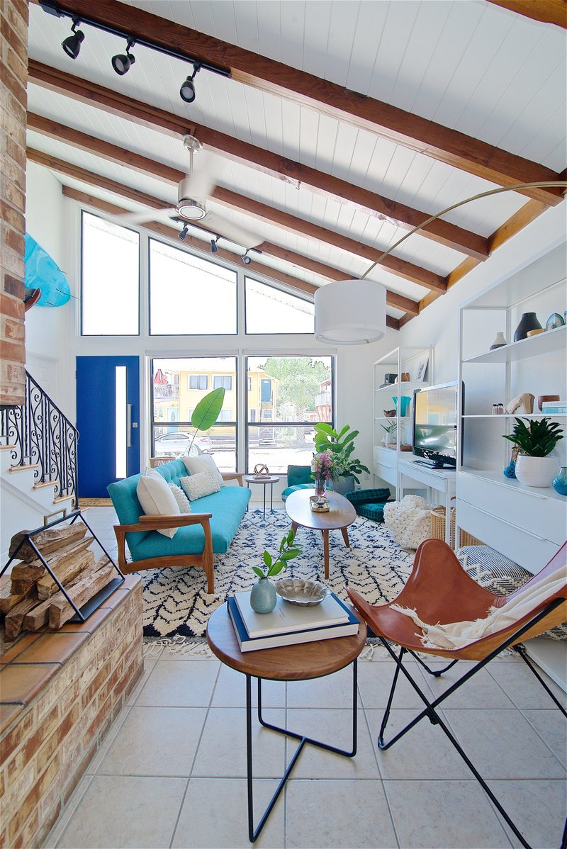 Midcentury modern and bohemian influenced living room by Denver based interior designer Fernway & Avalon