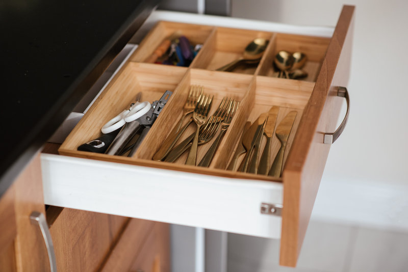 Canva - Silver-colored Cutlery Set on Brown Wooden Dresser