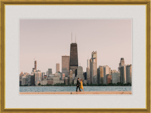 Chicago engagement photo with white matting and gold frame.