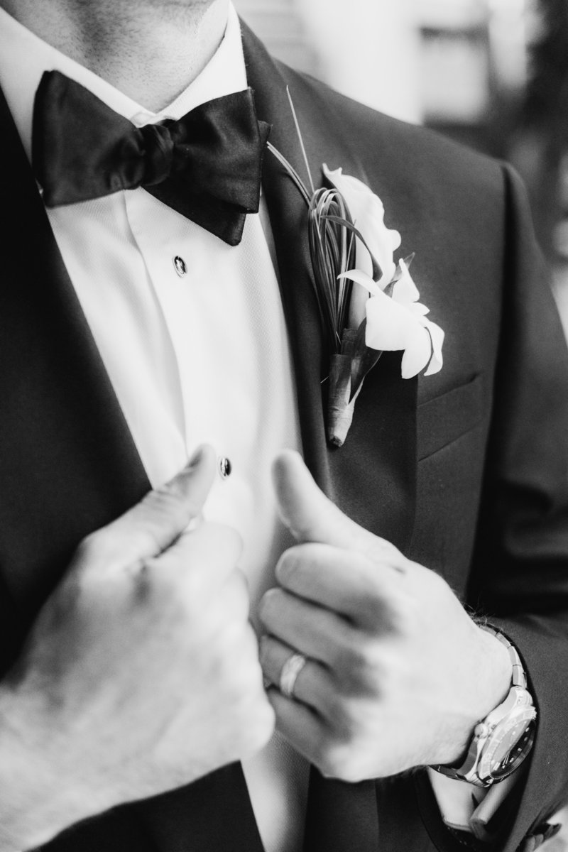 groom adjusting suit at Don Cesar wedding in St Petersburg Florida by Costola photography