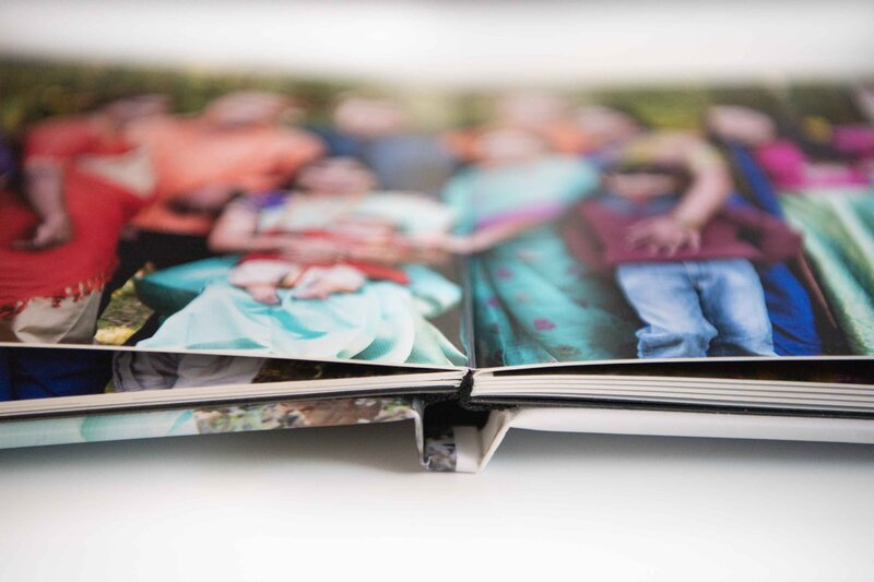 Showcase large family portraits in a photo book