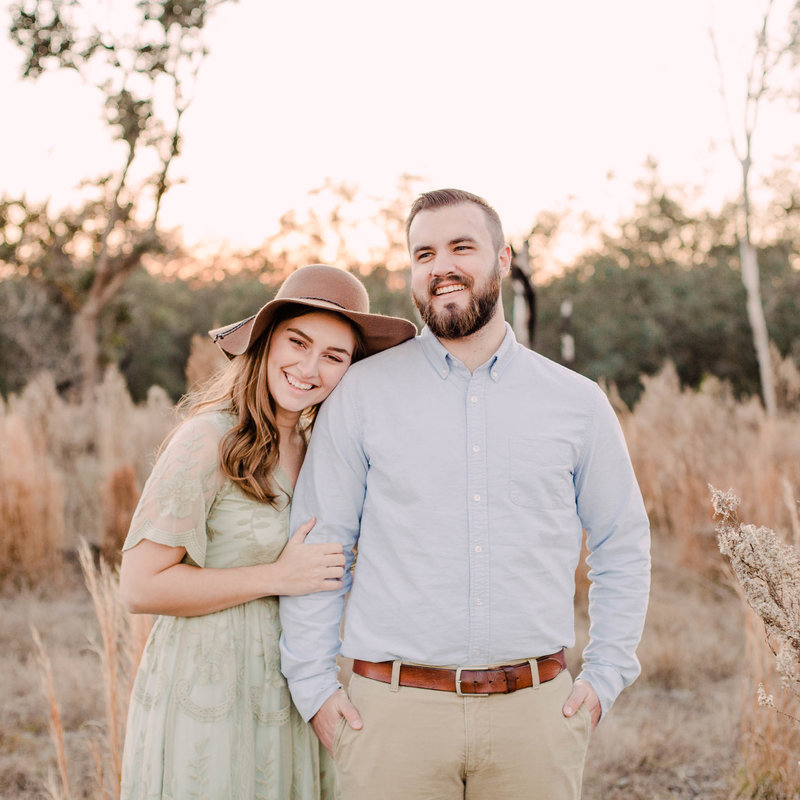 Embroidered dress and floppy brown hat engagement photos