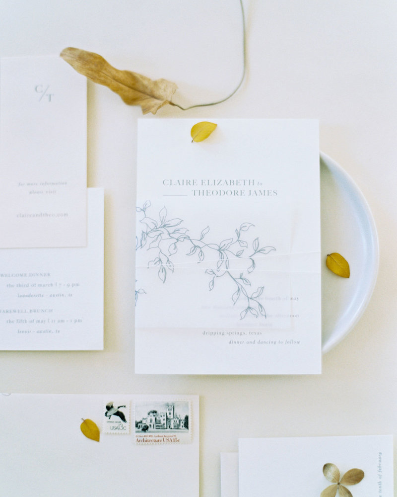 Semi-custom invitation suite Sereno by Dominique Alba with botanical illustration vellum wrap