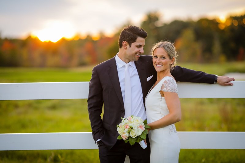 Bride and groom smiling at sunset outdoor summer wedding