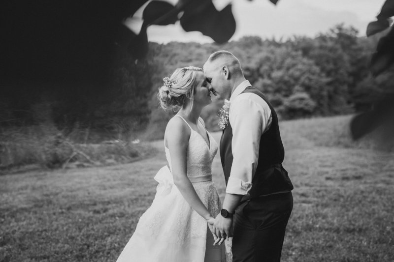 Chris and Kailee kiss after their wedding at Cypress Barn in Culleoka, Tennessee.