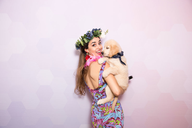 photo booth party with a puppy and flower crowns