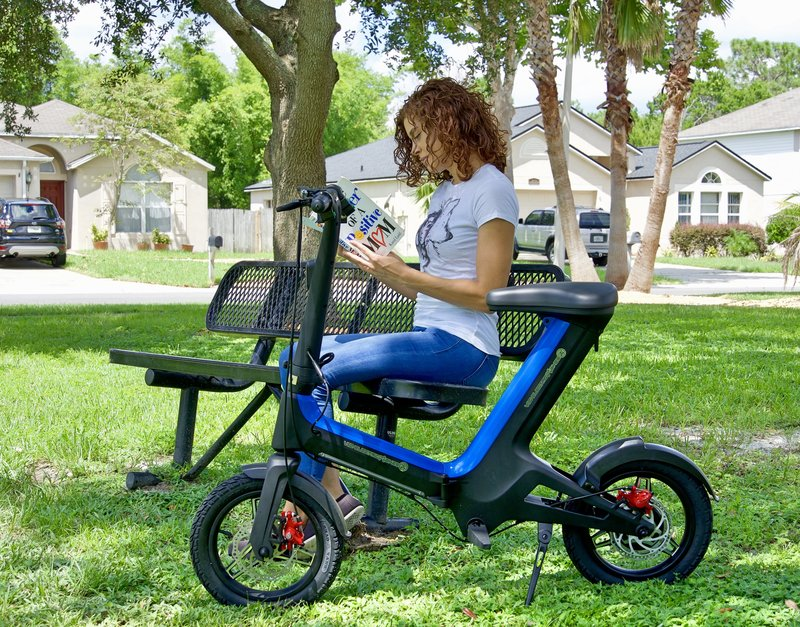 Relaxing day at the park reading a book with her Blue Go-Bike M3 beside her