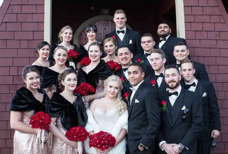 bridal party formal black and white with red flowers