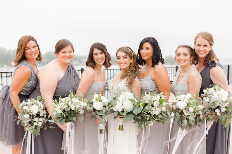 Bridesmaids with florals and gray dresses