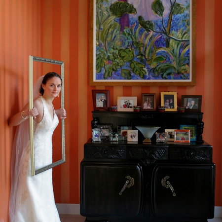 MOB writes photographer a great review. Brides mom owned an art gallery, bride poses in frame for a bridal portrait session in LeaWood Kansas