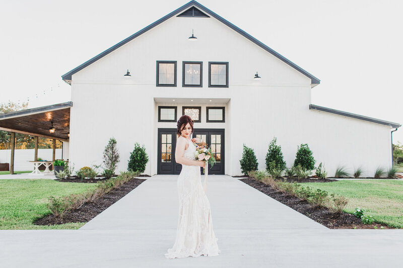 The Barn at Willowyn Bride Standing in Front of the Venue - Houston Wedding Photographer-1