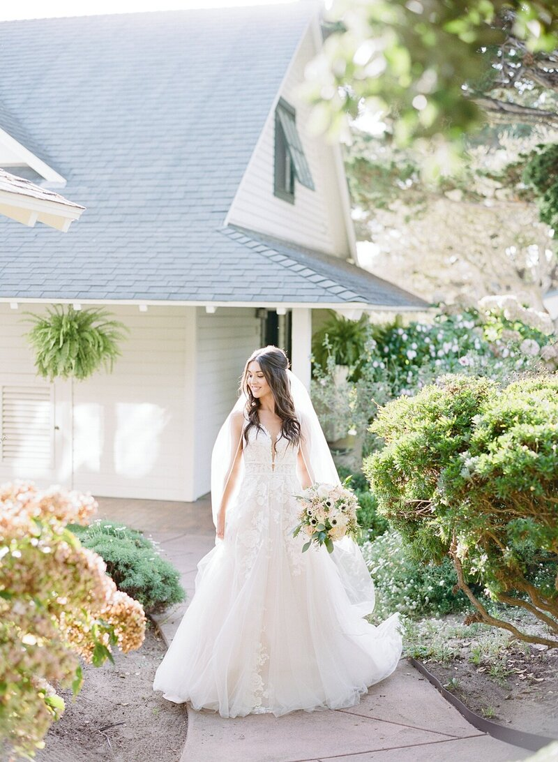 bridal portraits at Mission Ranch Carmel in front of cottage