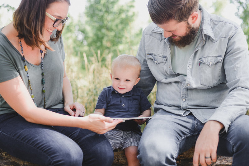 Mom and dad reading to son, lifestyle photographer in Colorado