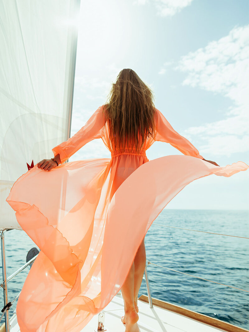 beautiful girl boating ocean - bookitbox TRAVEL