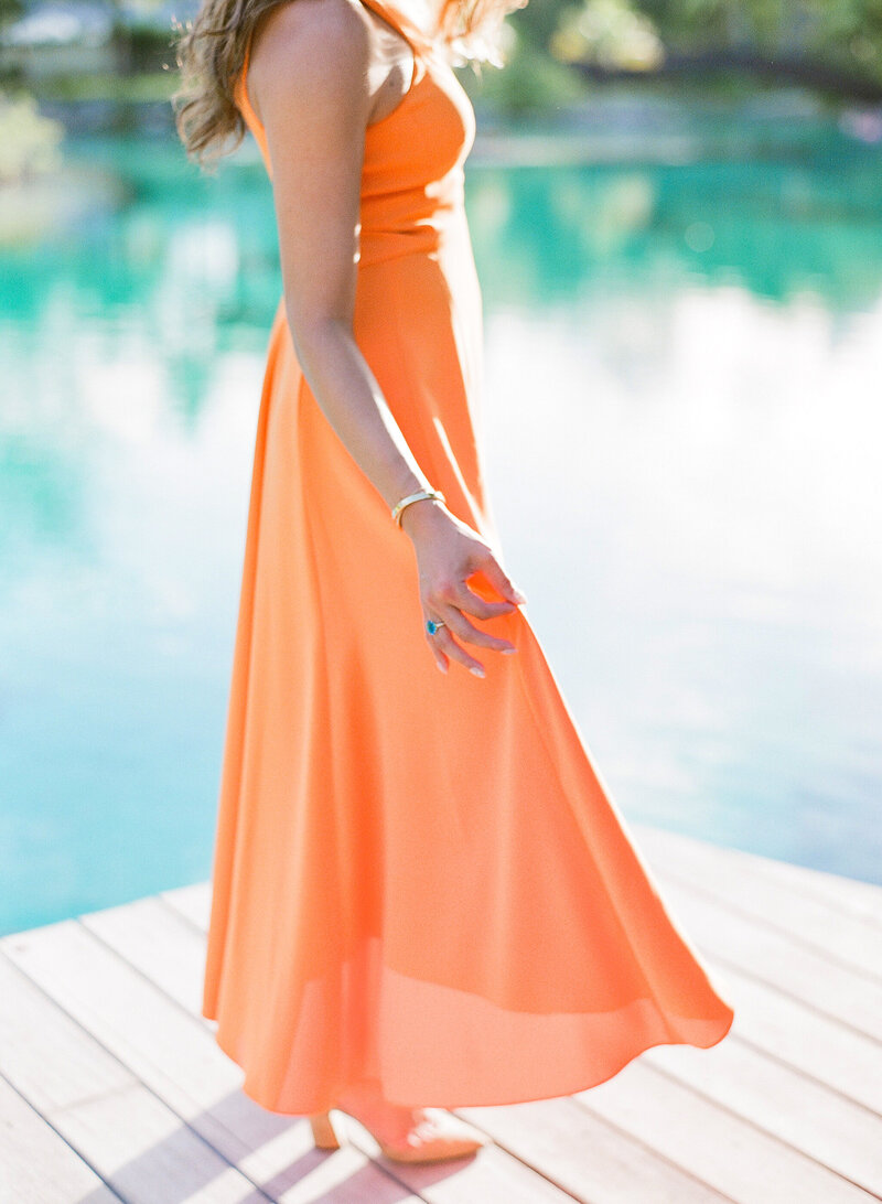 The bride in her orange dress at the St Regis Bora Bora