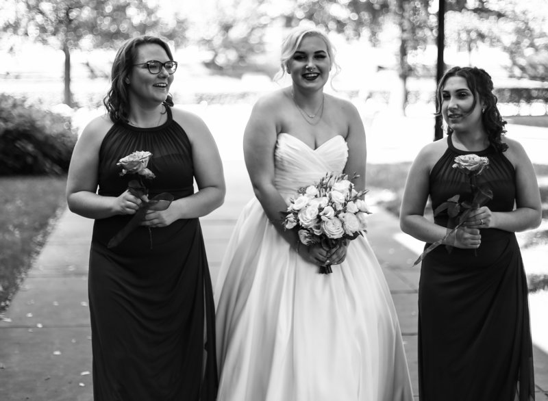 Bride with her bridesmaids outside the Cathedral of Learning in Pittsburgh, PA