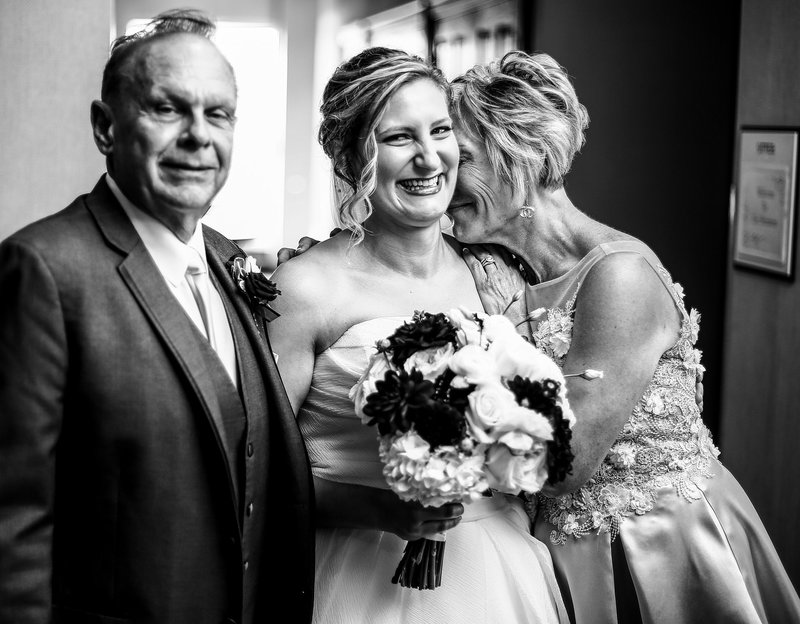 Bride with her parents at the Sheraton Erie Bayfront Hotel